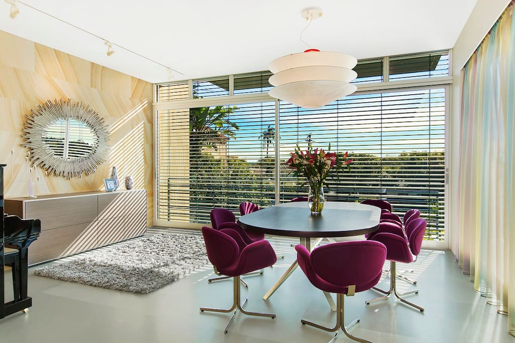 Formal dining room with glimpses to Sydney harbour.