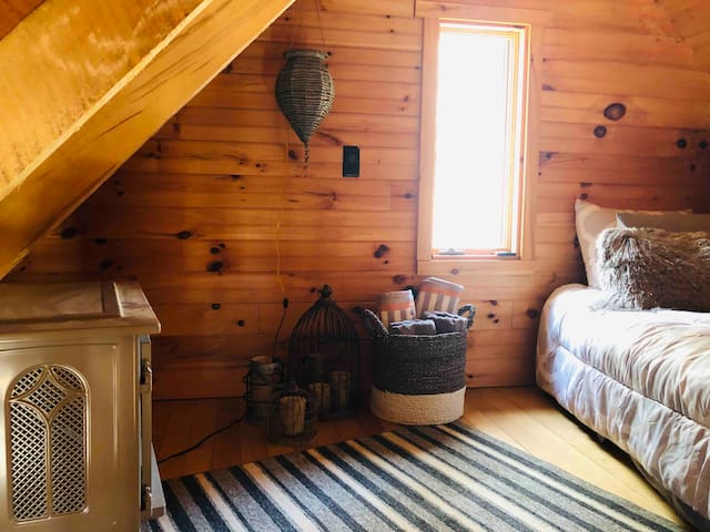 Queen bed and cozy surroundings make for romantic accommodations