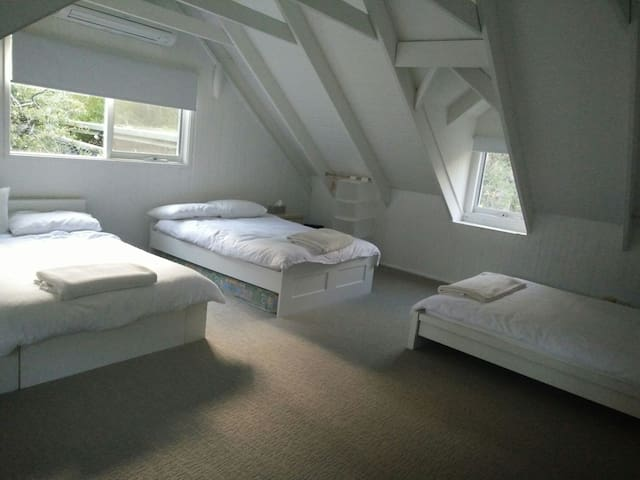 Upstairs bedroom, one queen and two double beds, room 5.5 metre square