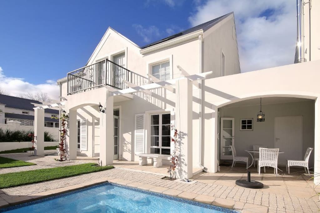 Front garden with covered terrace & pool