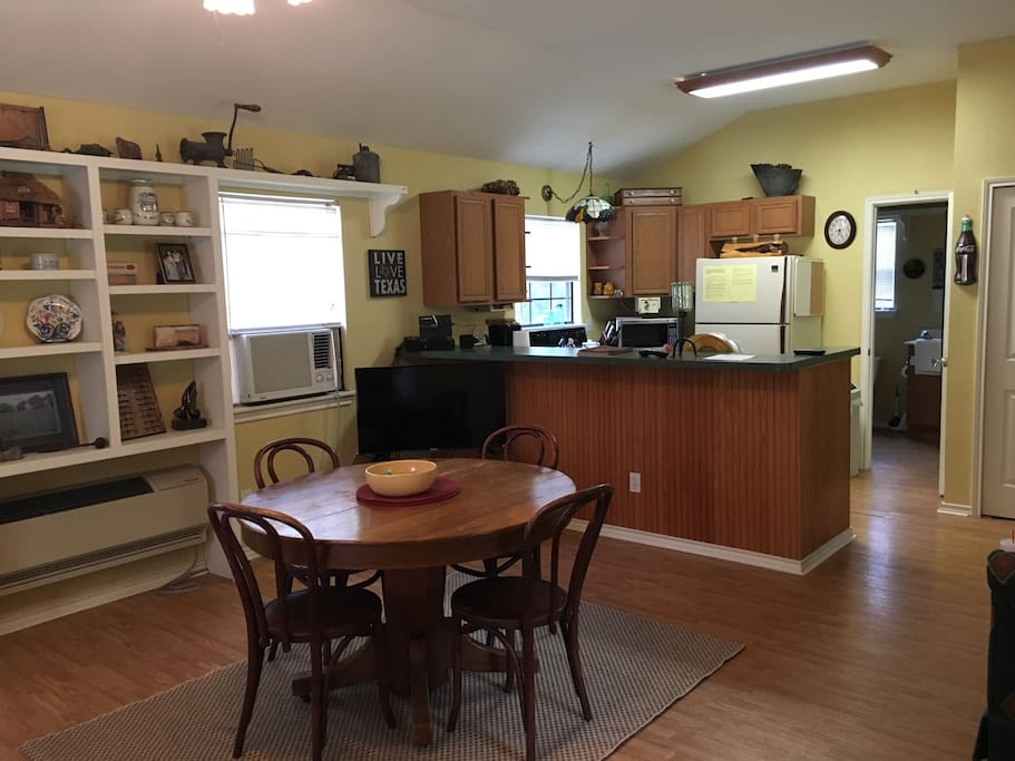 Dining area and fully stocked kitchen.