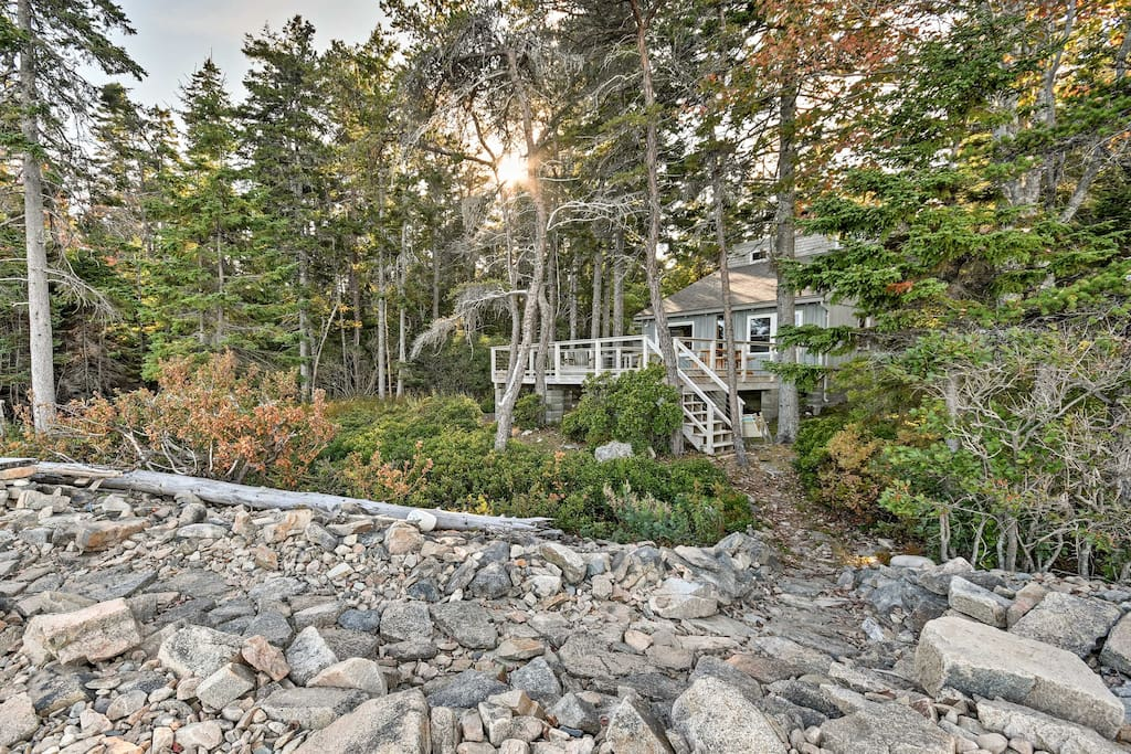 Nestled in the woods on 2.5 acres, this Maine getaway is an outdoor oasis.