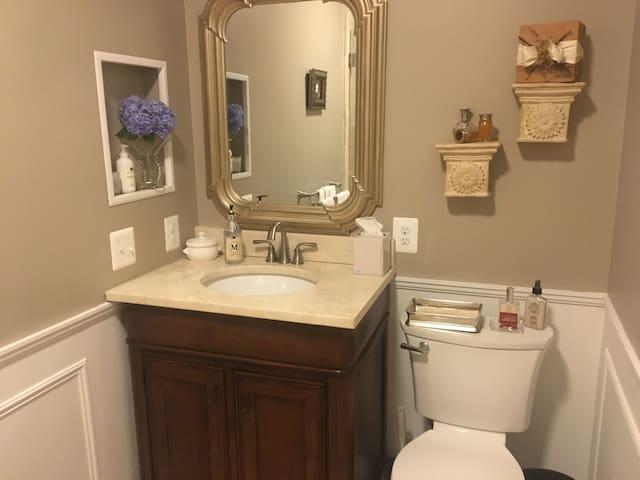 Beautiful sink and accessories adorn this gorgeous updated bathroom for guests to use.