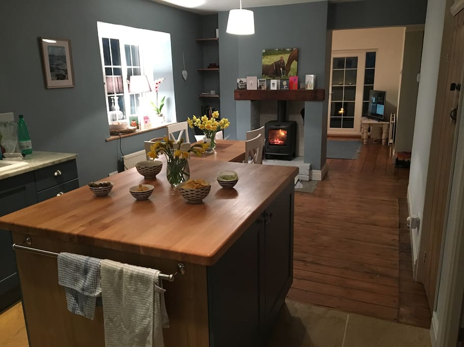 Kitchen, dining table and wood burner