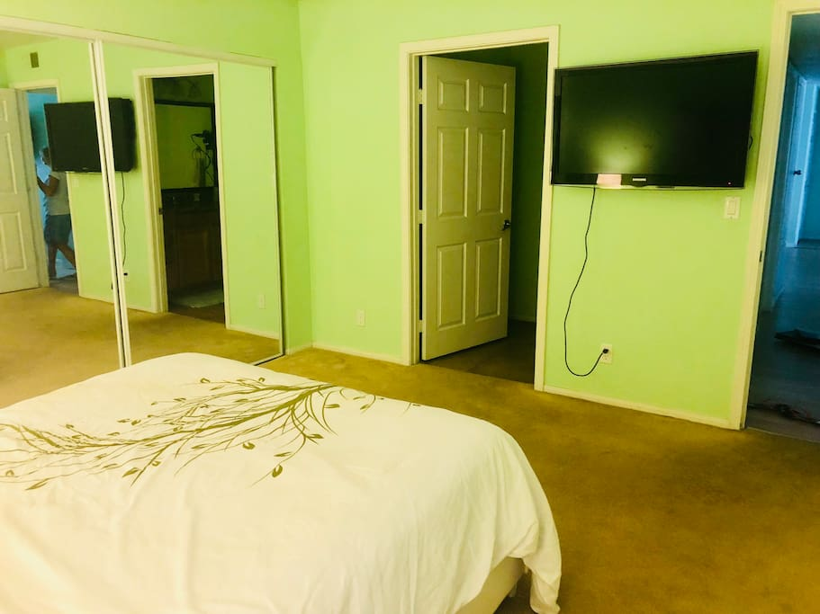 Your Bedroom with 46 inch TV and bathroom opening from your room