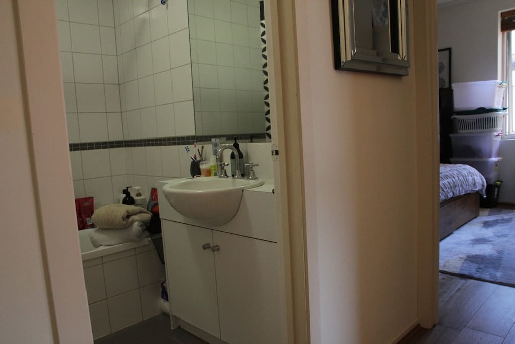 Small bathroom with bath, shower and toilet.