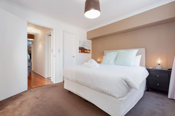 Bedroom 1 - Sleep in Style on this King size bed with TV and private balcony!