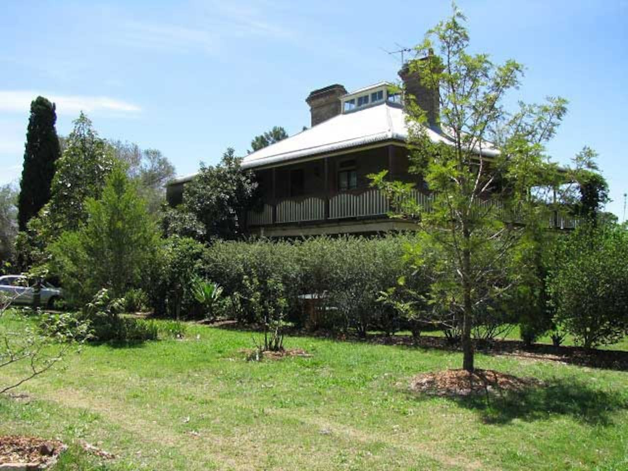 The Oaks is a beautiful Victorian home circa. 1880 surrounded by peaceful manicured gardens.