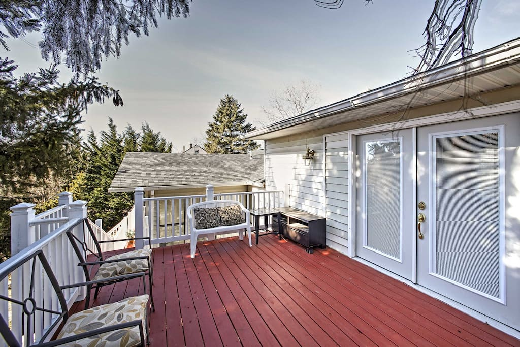 Spend afternoons lounging on the spacious deck that overlooks the private backyard.