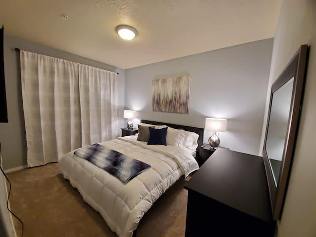 Master bedroom (bedroom 1). Enjoy a king size bed, 2 nightstands, a 3 drawer dresser, additional storage, and your own private en suite bathroom.