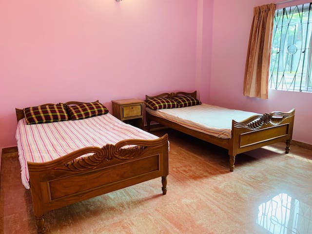 Bedroom with 2 single bed also all facilities