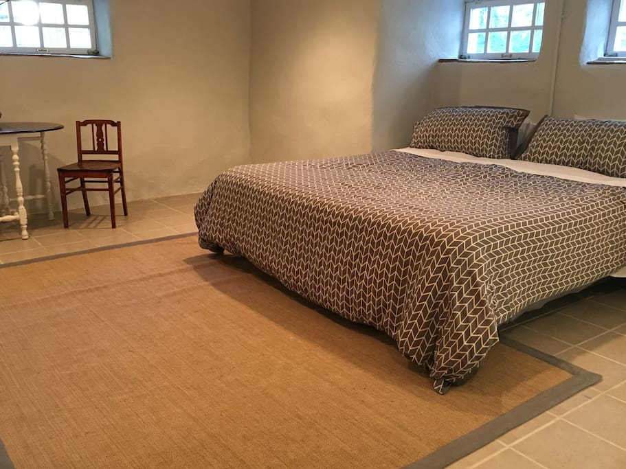 Comfortable king-size bed with Egyptian cotton sheets