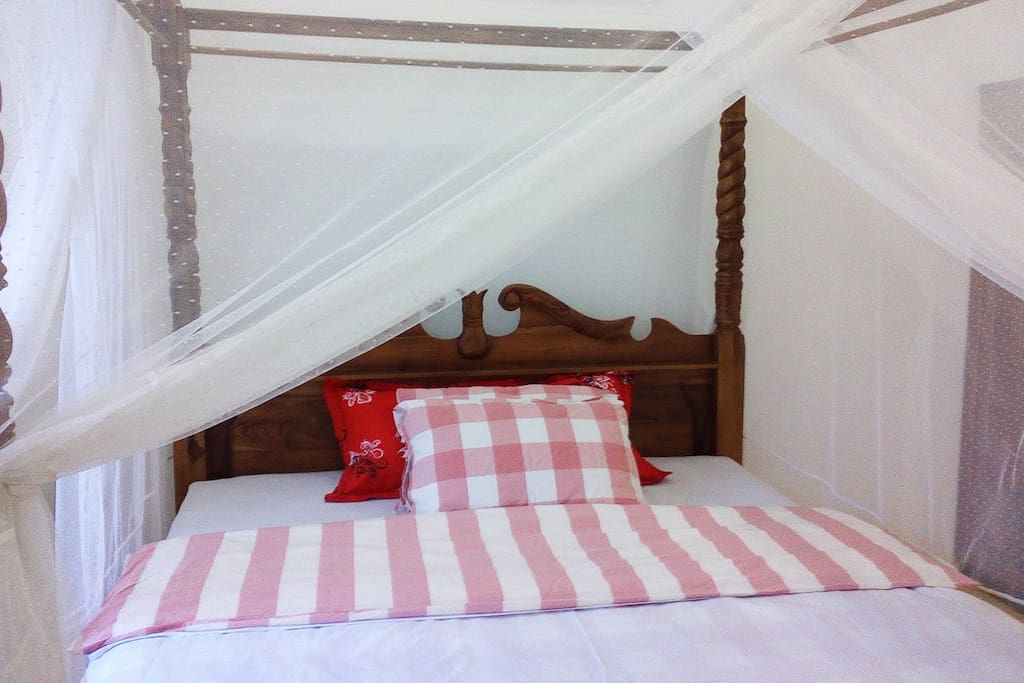Beautiful romantic bed. mosquito net and Air conditioning.