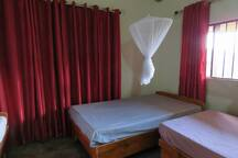 Lakeview Cottage: Bedroom 2 with 3 x single beds with shared shower + toilet, kitchen and veranda.