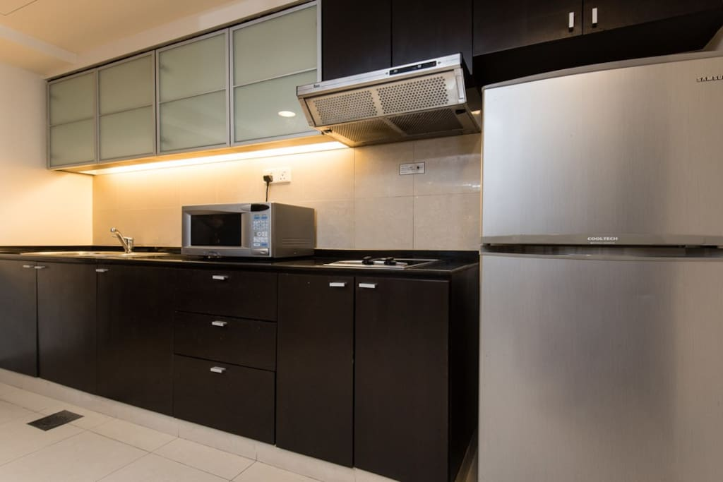 Fridge and kitchen with cooking facilities