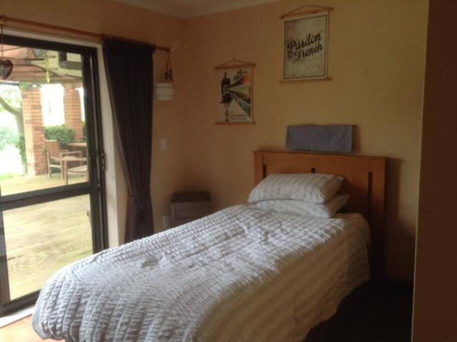 This room has a king single bed which can be made into a super king sized bed. It does take up most of the room when extended. We also have other rooms, see our other listing.