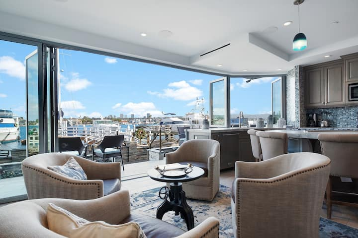 Inviting waterfront home w/ bay views, multiple balconies, & a private hot tub