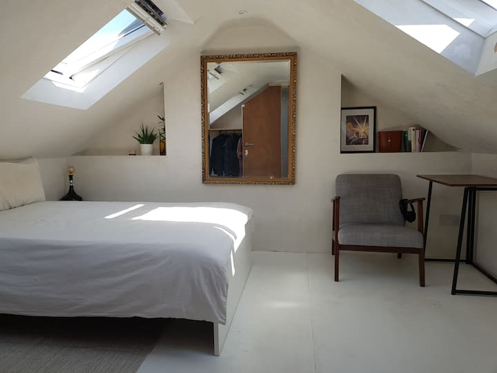 Bright loft room in a clean & comfortable flat