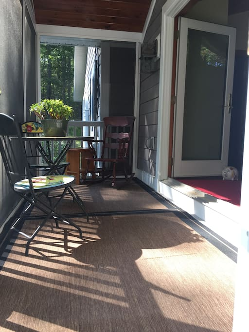 Screen porch with entrance to living room