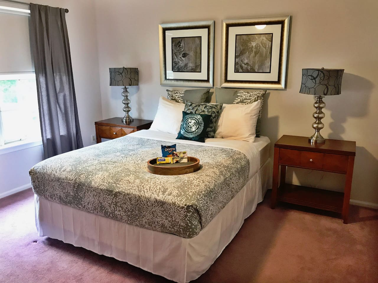 Large Bedroom with queen-sized bed.  Lots of natural daytime light. Room includes flat screen HDTV with premium digital cable (including HBO, Showtime, CineMax, Encore, &Starz). A welcome snack will be left in the room for you to enjoy upon your arrival.