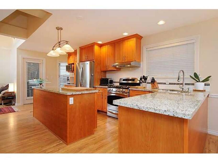Open kitchen (bottom floor, adjacent to open-space living room area)