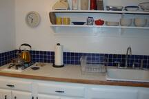 Fully furnished kitchen, even has a skylight!