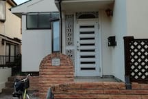 White two-storied charming house that is located quiet residential area.