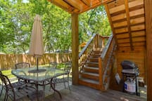 Lovely shaded deck allows for dinners alfresco.