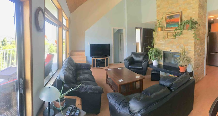 Main floor living space is bright. 2 story vaulted ceiling with local redwood cedar plank. Unforgettable lake and mountain views from this area both day and night. Smart TV, wood burning fireplace, access to downstairs (if booked with 2 bedrooms)