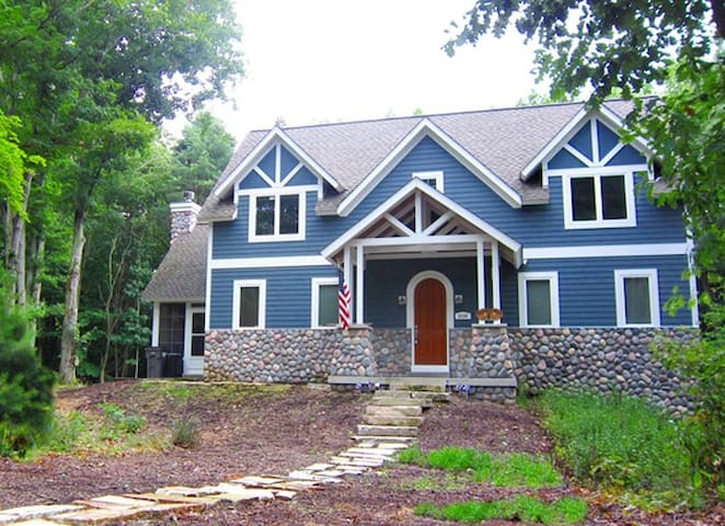 Thunder Road: Walk to Lake Michigan beach from this beautiful home with private screen porch and fireplace