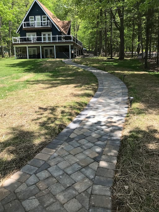 Paved walkway from house to the dock