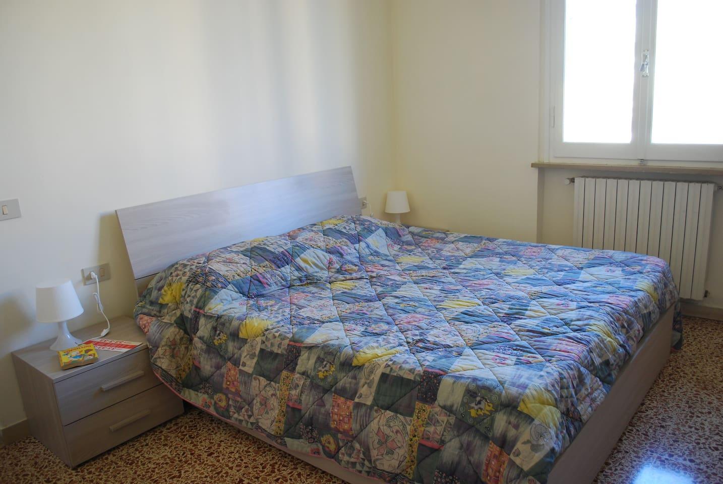 Camera da letto per gli ospiti.