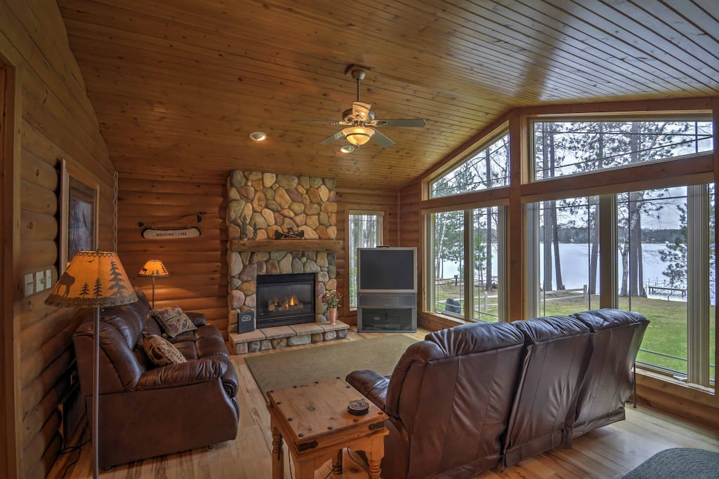 Warm up beside the large stone fireplace and enjoy the nature views through the windows in the living area.