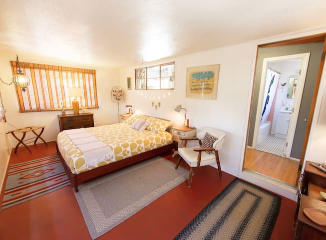 This is the master bedroom. It has a comfortable king size bed and it's own air conditioning unit.