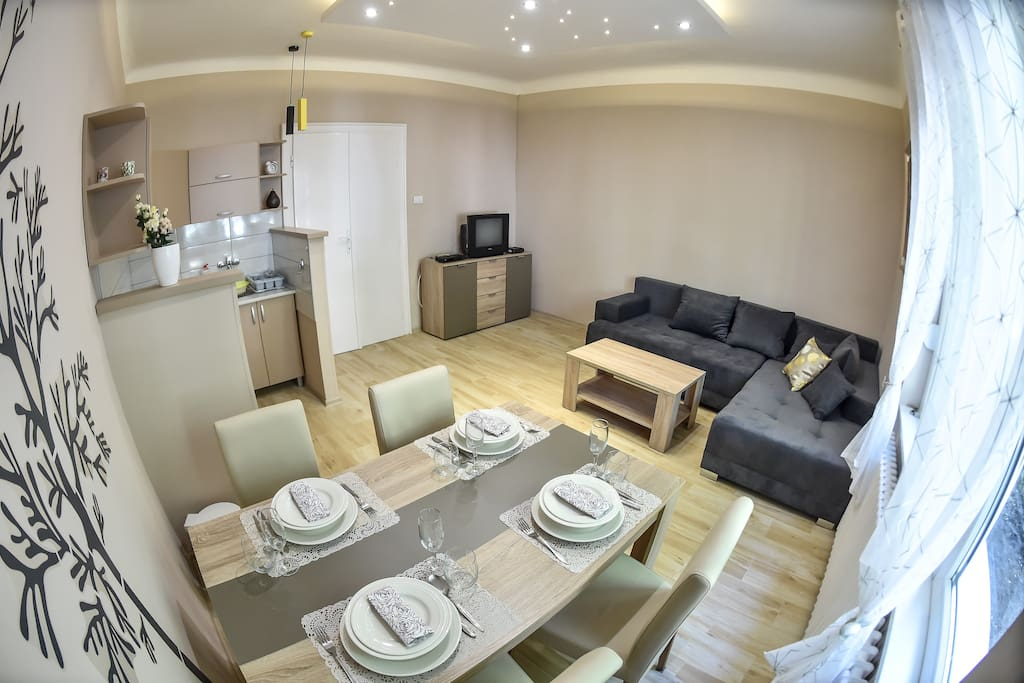 Dinning table with living room and kitchen