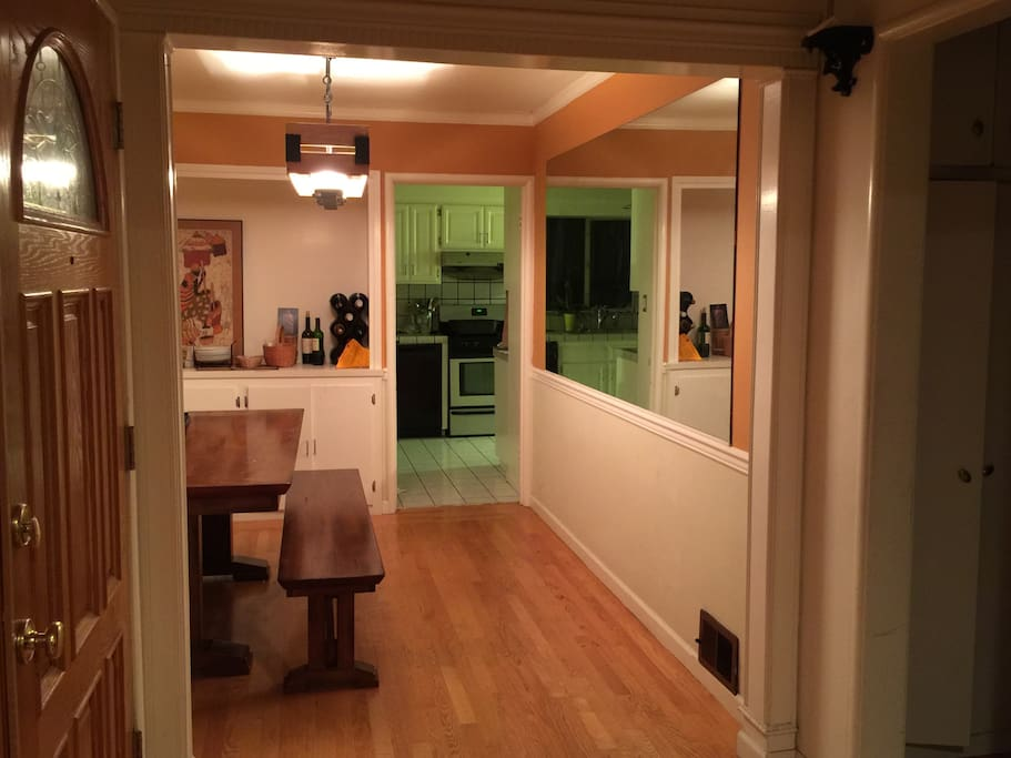 View from the living room into the formal dining room and the kitchen is beyond the dining room.