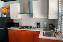 The modern style kitchen, loaded with all the necessities. Fridge, microwave, coffee maker and even a rice cooker!