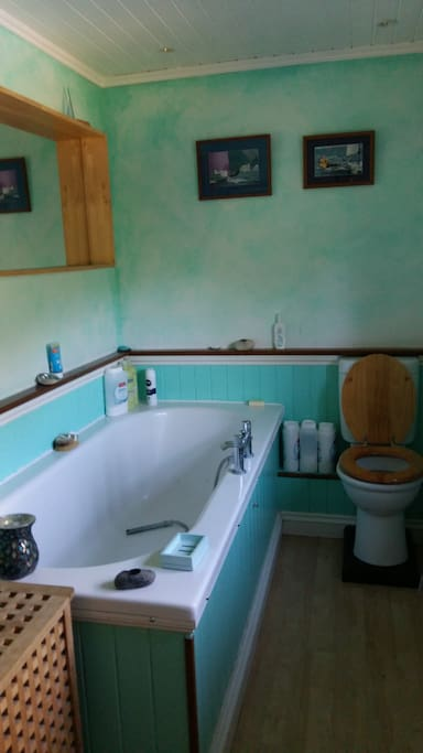 Upstairs bathroom with large deep bath. Additional shower room downstairs.