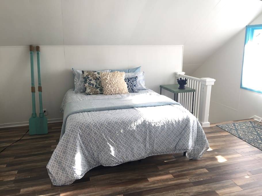 Beautiful comfortable queen size bed. Bright and airy throughout the day. Stair entry way to the right.