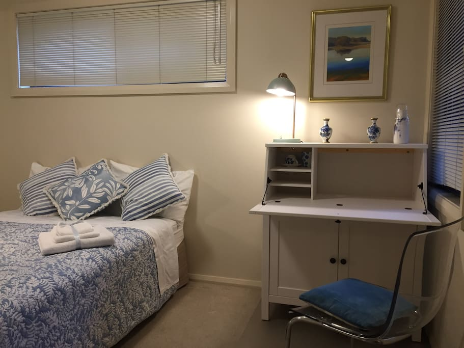 Comfortable double bed room and work desk