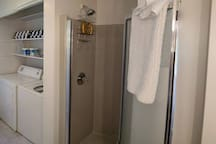 Shower in laundry room.