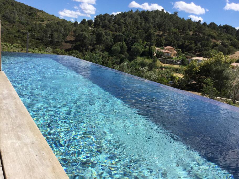 Infinity pool over wineyard and Orb river valley