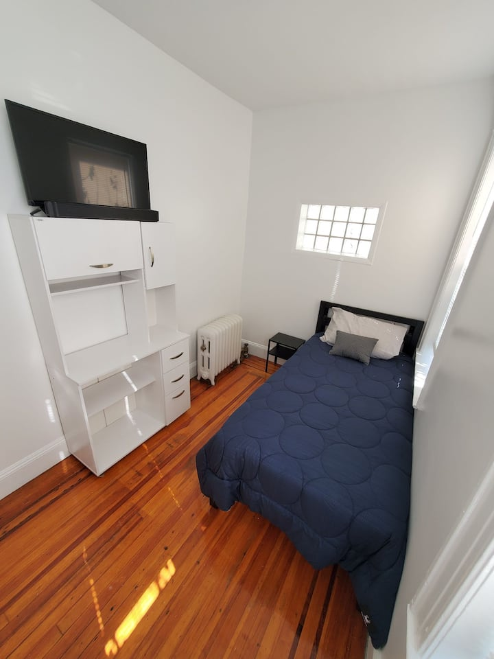 Clean white room with 3 windows and TV & Soundbar