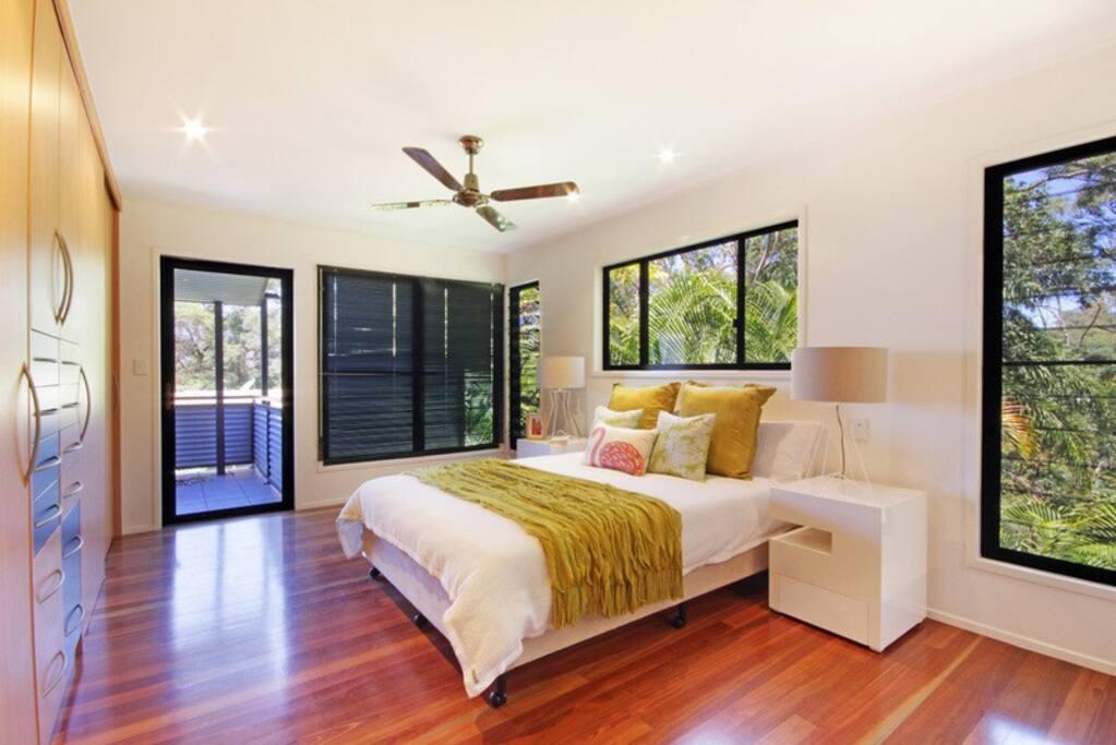 main bedroom with open plan spa bath room.