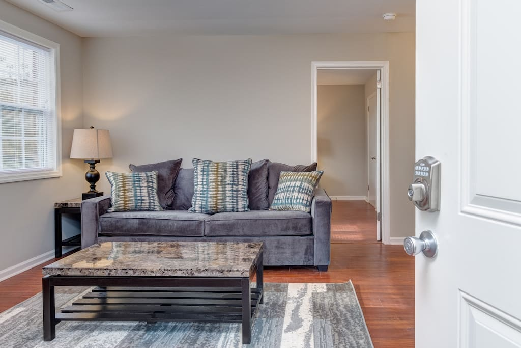 Located in the historic Edgehill neighborhood, the duplex is tastefully decorated with stylish modern furniture.