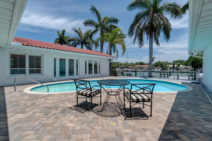A Boaters Paradise! Large waterfront private home, pool, boat slip, minutes to the beach