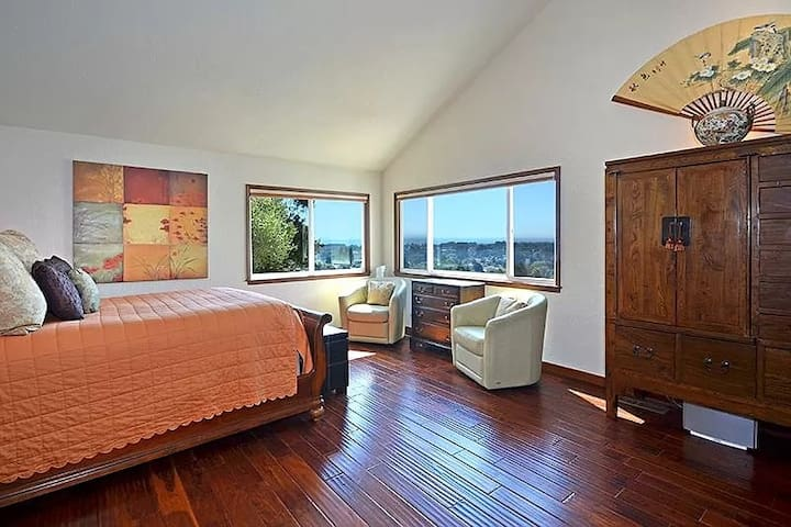 Panoramic views of bay and garden from the master bedroom suite.