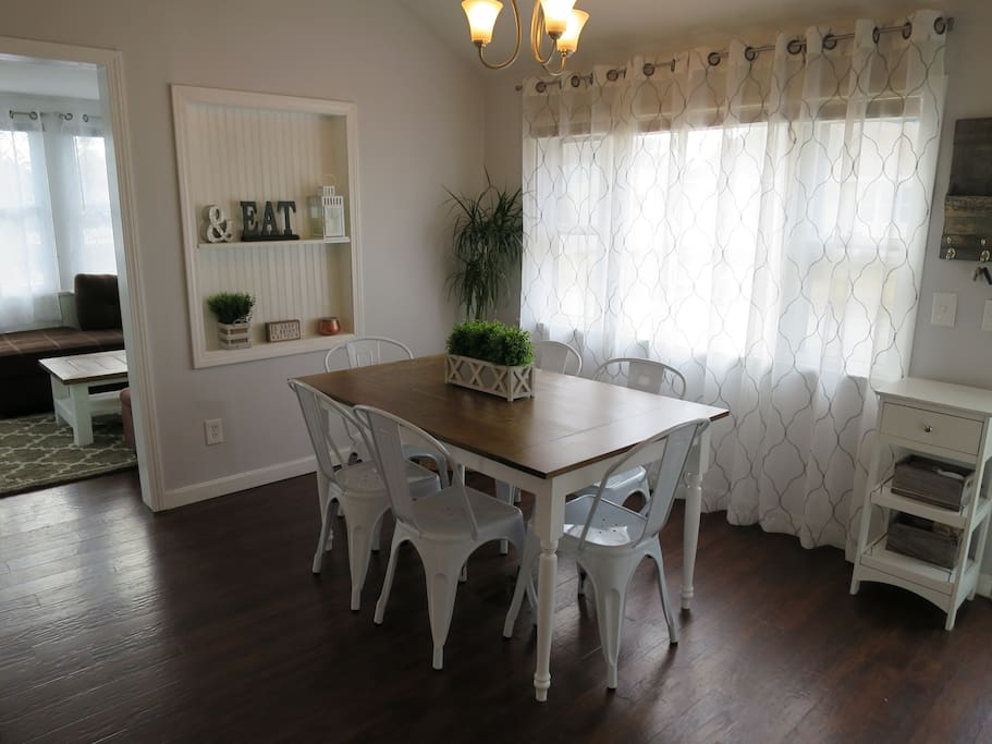 Dining area with farmhouse table and 6 chairs