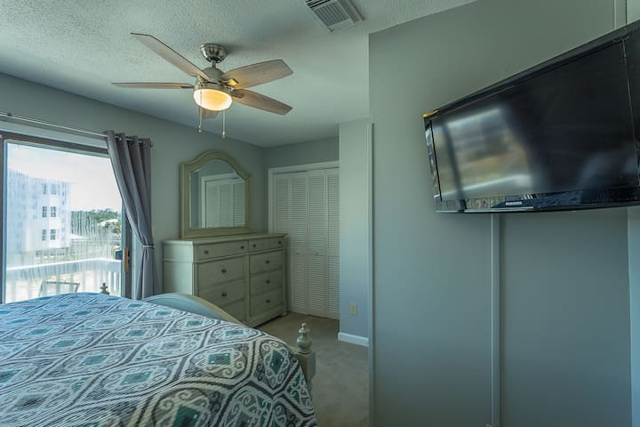 King 2nd Bedroom with Flat Screen Cable TV/DVD, Ceiling Fan, and Alarm Clock