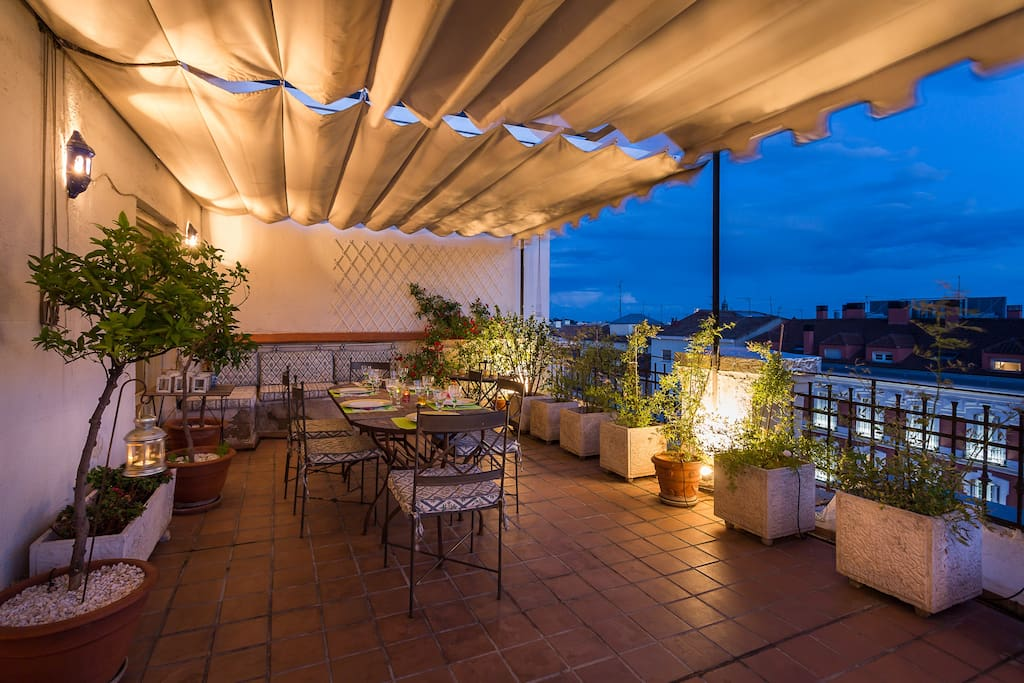 Well lit terrace at night with great views of Madrid lighting.